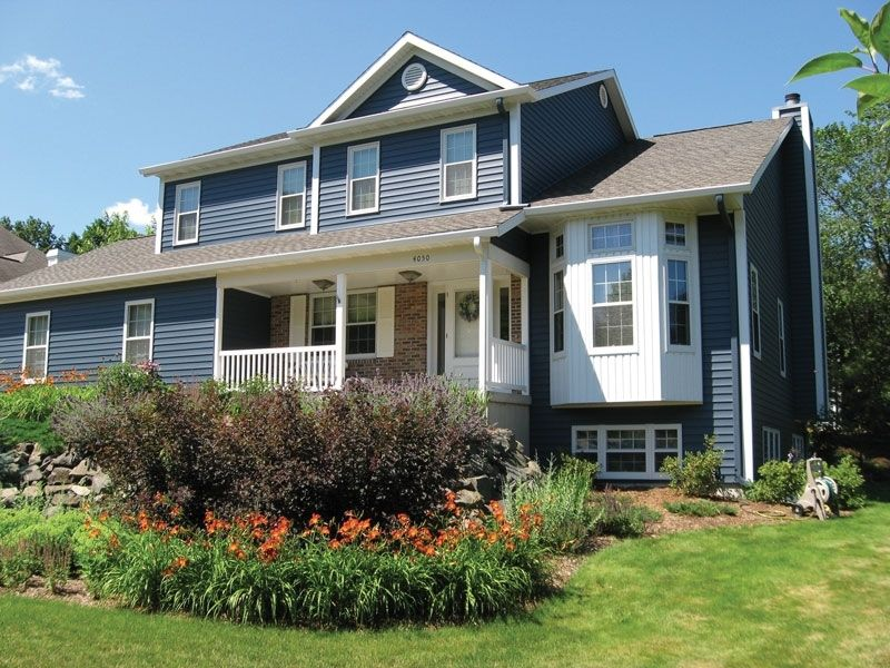 Home with seamless steel siding Steel siding, House