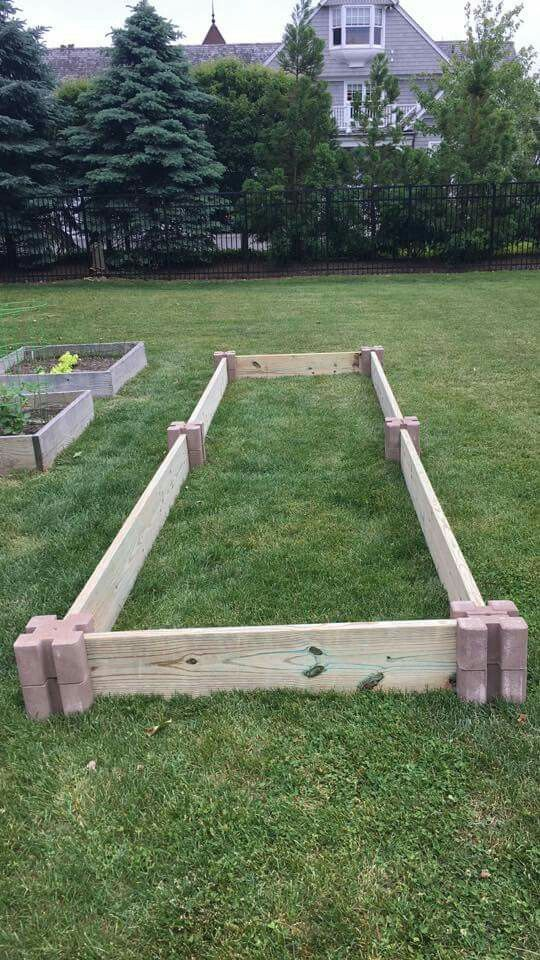 Next time I build a raised bed       corner blocks from home