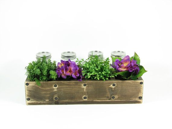 Great idea to welcome someone in their new home.  New plants and mason jars with recipes in a vintage planter.