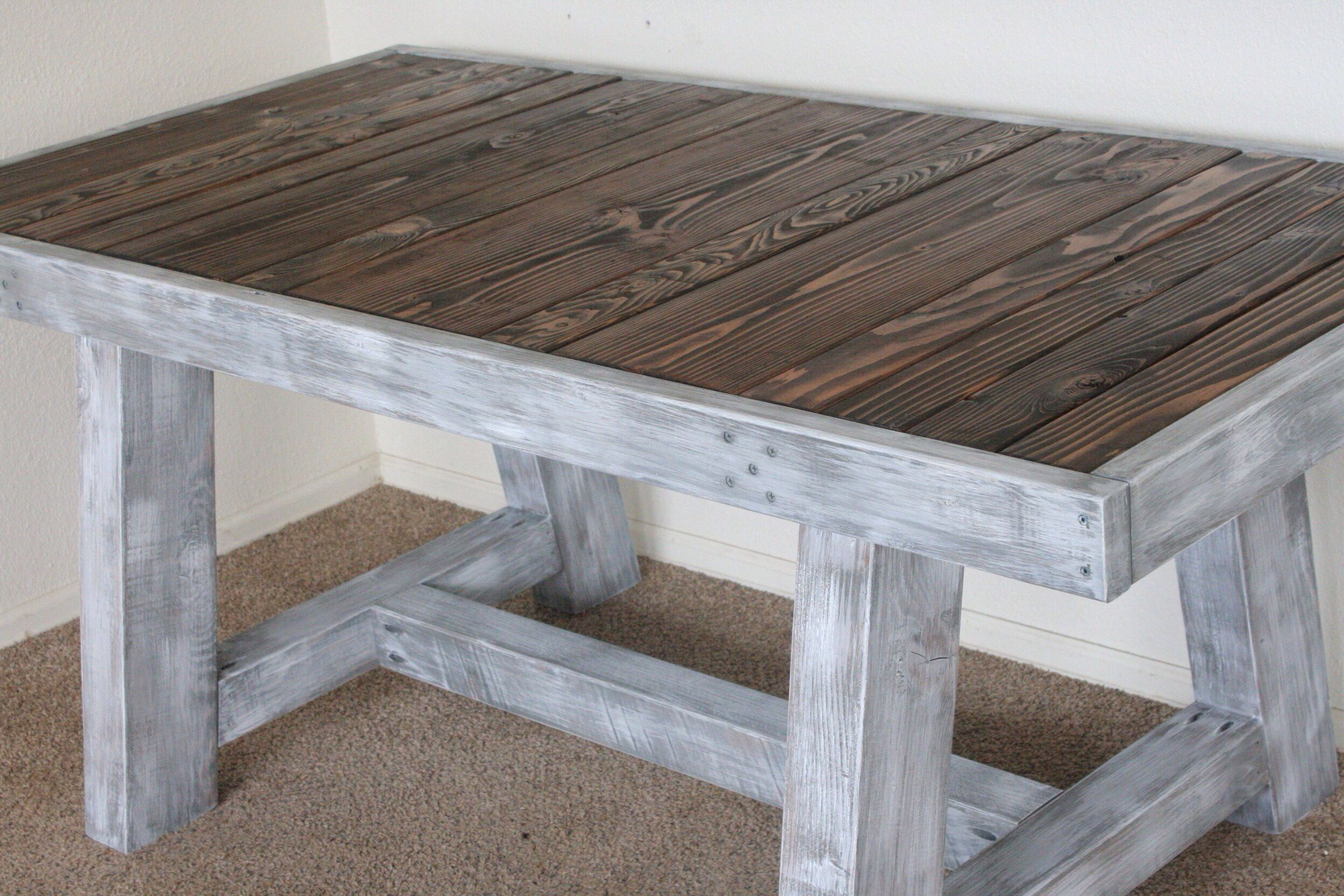 Pieced top dining table with dark walnut stained top and custom gray white wa