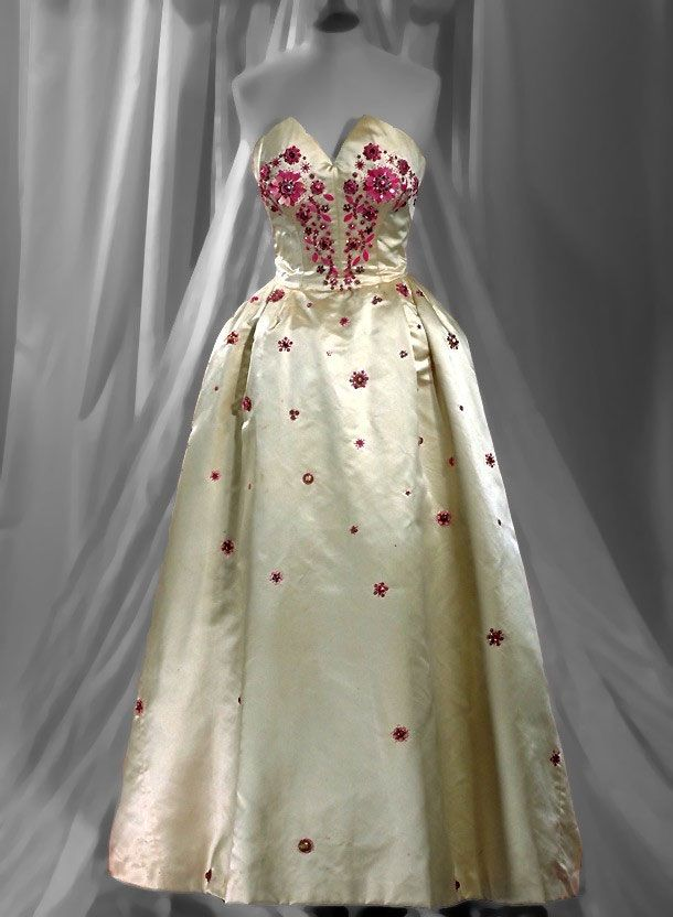 Beaded silk satin gown by Norman Hartnell, 1953 ... the flower placement is striking for 1953.
