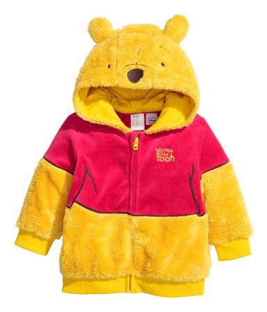Winnie the Pooh Pile jacket with appliqués. Lined hood, zip at front, and ribbing at cuffs and hem.