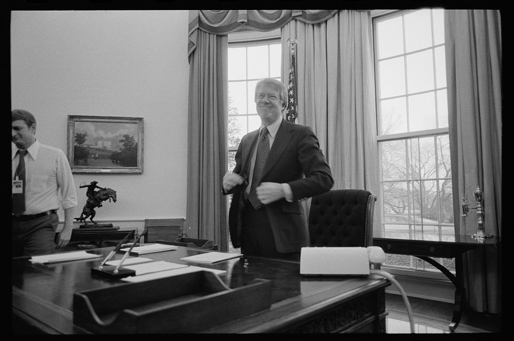 jimmy carter oval office. President Jimmy Carter Standing Behind His Desk In The Oval Office Of White House, U
