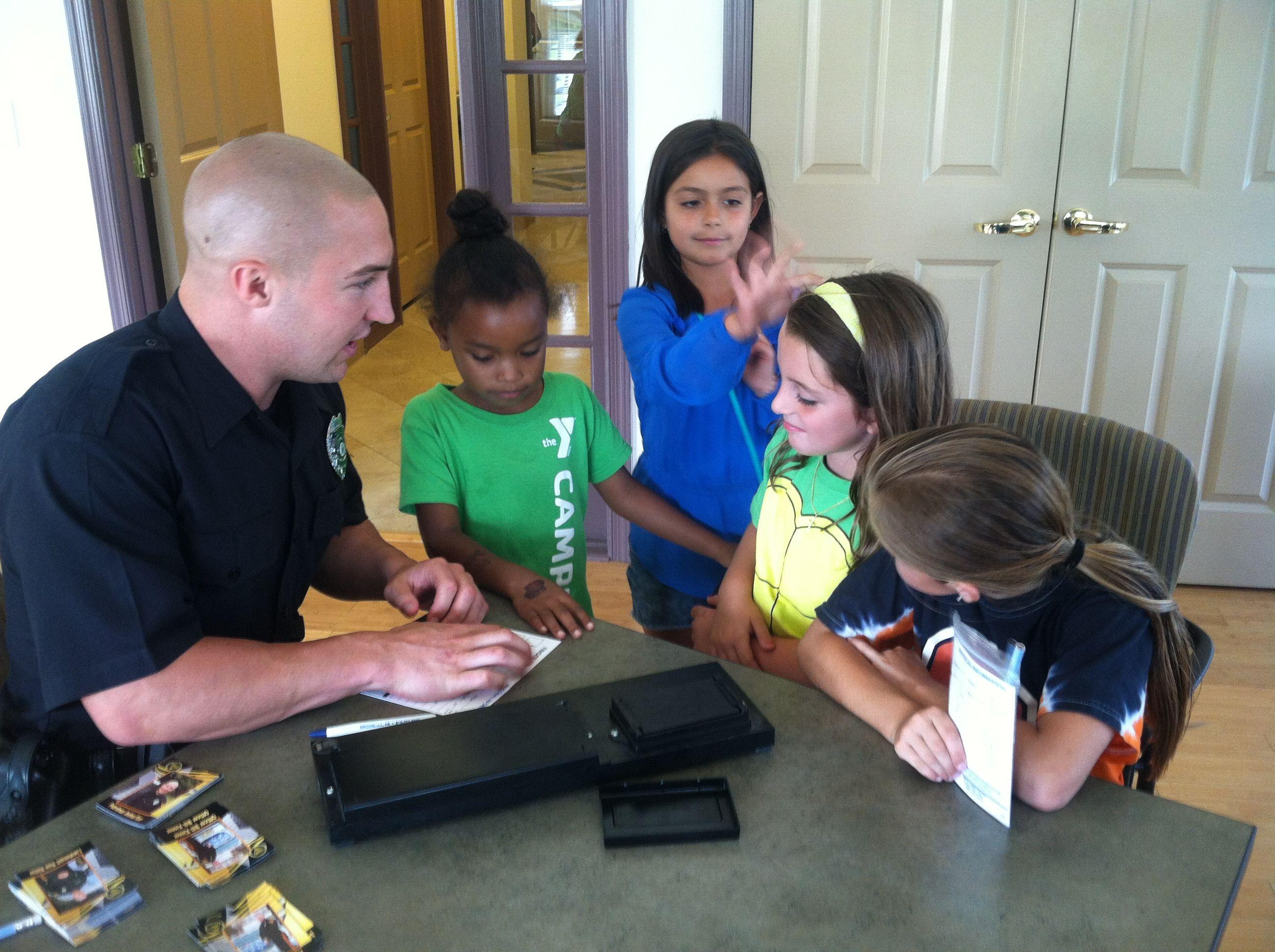 Ofc. Kerr filling out the safety kits. Safety kit, Child