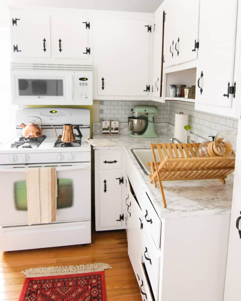 before and after the secret to successfully painting old kitchen cabinets kitchen cabinets on kitchen cabinets painted before and after id=48875