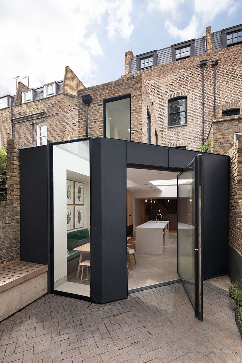 A Rear Extension With A Pivoting Glass Door Has Been Added To This London Home