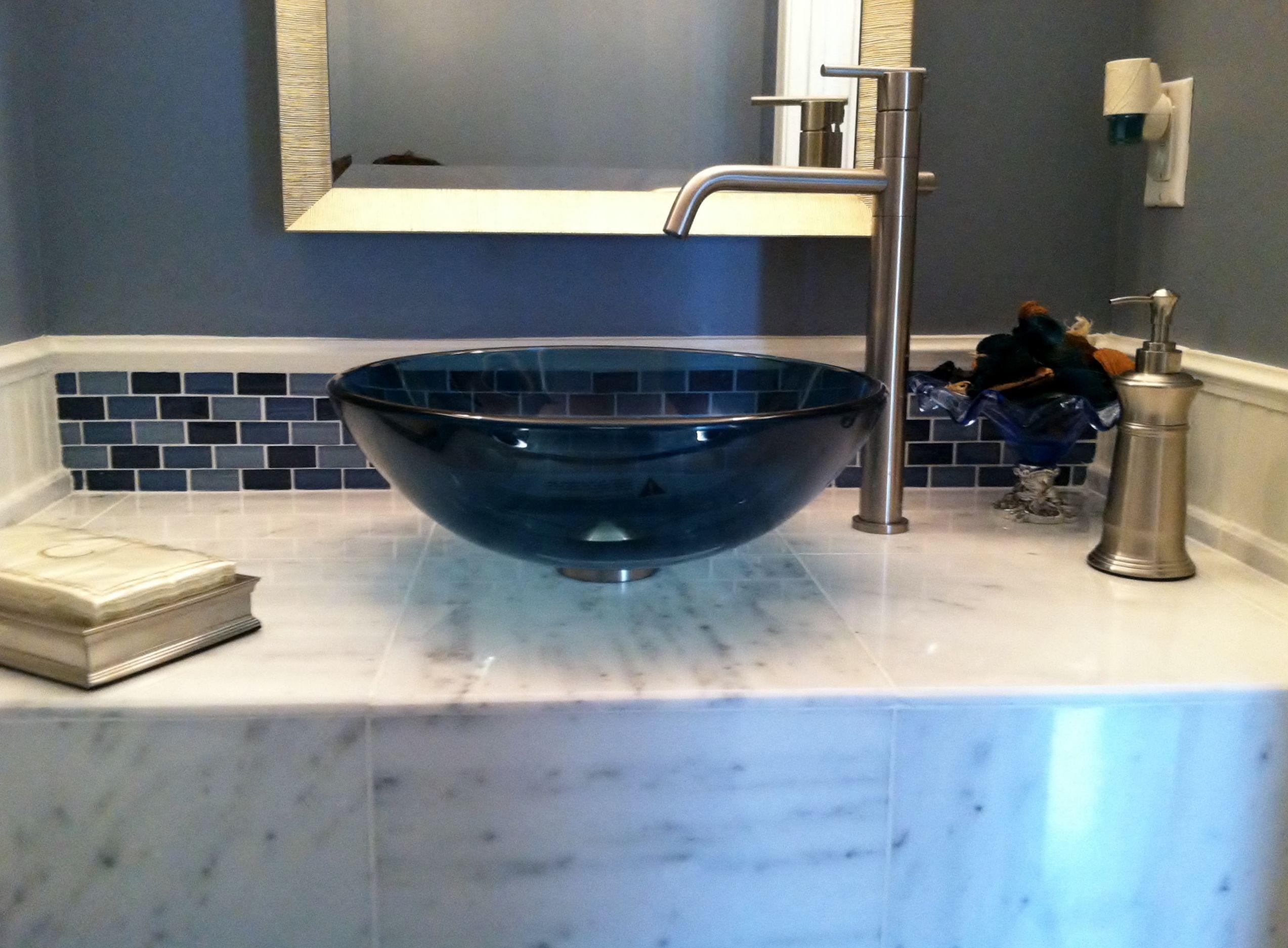 Glass tile backsplash accent with blue glass sink, custom marble ...