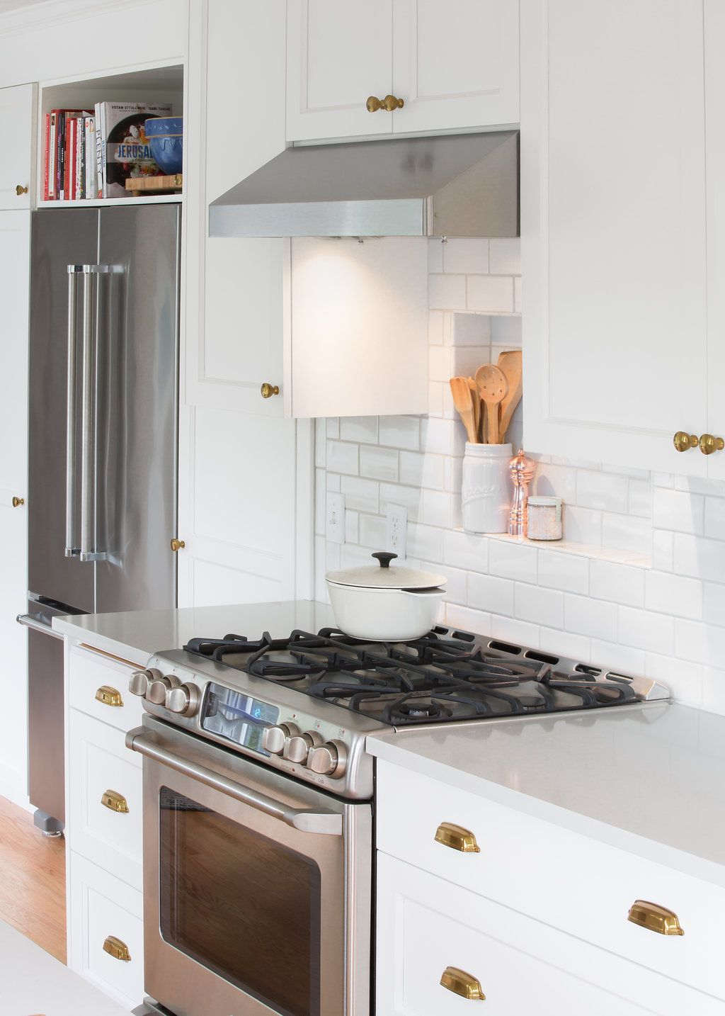 Cute Tile Shelf Behind The Range In A Traditional All White Kitchen With Quartz Countertops And B Magnolia Kitchen White Ikea Kitchen Black Kitchen Countertops