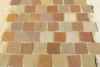 These lovely rustic Sandstone block paving setts have a wonderful warn and tumbled appearance that is perfect for creating paths, driveways and patios and can also be used as edging for sandstone paving or our range of paving circles.  Available in Meadow Blend and Coastal Mix colours. #AWBSBlockPaving #SandstoneSetts