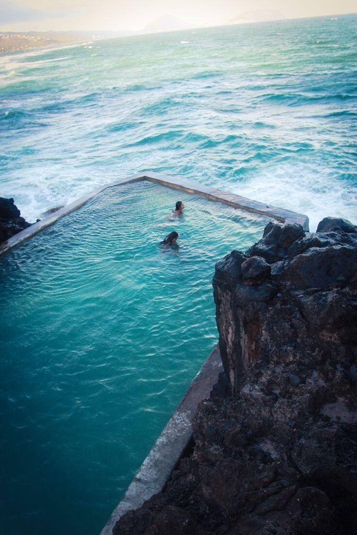 Oahu, Hawaii. Rocky Cliff Danger Pool Into Ocean