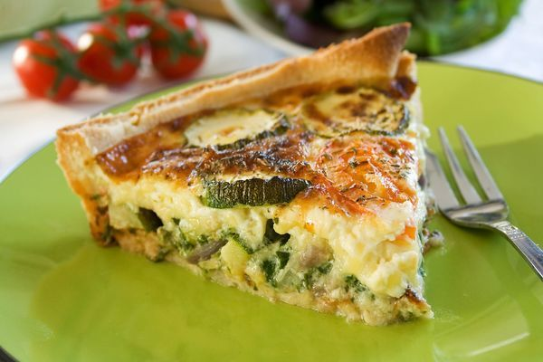 Tasty Vegetarian Dish: Cheesy Zucchini Quiche (Instead of a rolled pie crust, I would use a pie crust of shredded hash browns)