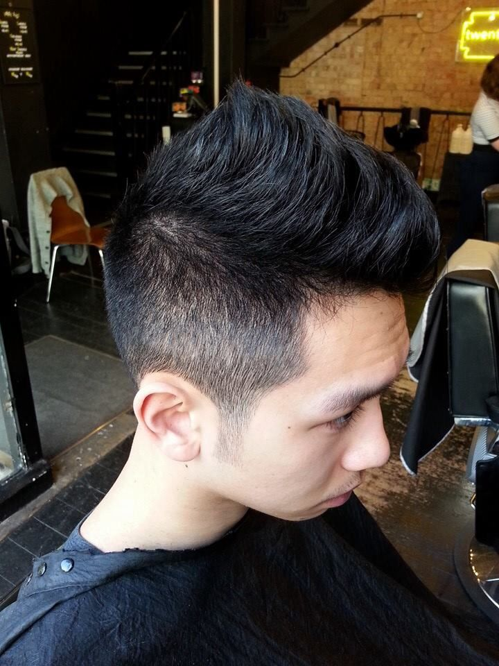 Grade 2 back and sides with a soft contrasted Mohawk shape on top ...