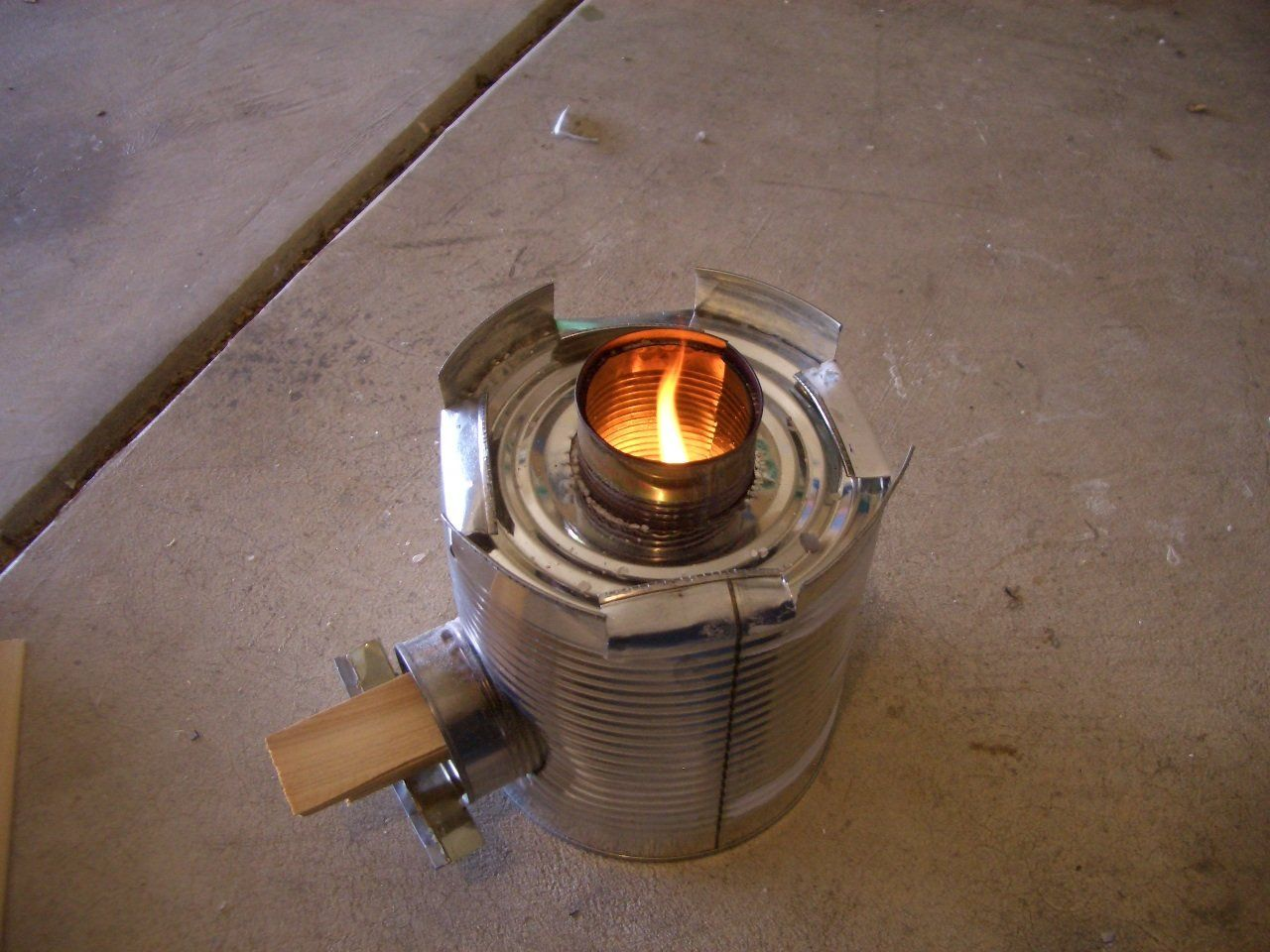 This instructable will show you how to easily make a functional rocket stove from recyclable cans for almost no cost.Items you will need: 1 - No. 10 Can (Standard restaurant size can. Mine was a pineapple chunks can from a local pizza parlor. They gave it to me free.) 4 - Regular soup cans (Standard 10.75oz Campbell's Soup cans) Insulation material. I used Perlite. It's cheap and available at any garden center. I had it on hand for my garden. You can use sand, dirt, ashes, foam, any…