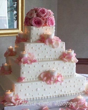 Square wedding cake with candles & flowers