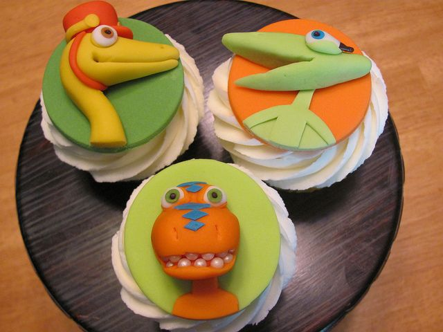 Dinosaur Train Cupcakes by zoeycakes, via Flickr - How cute are these?  Based out
