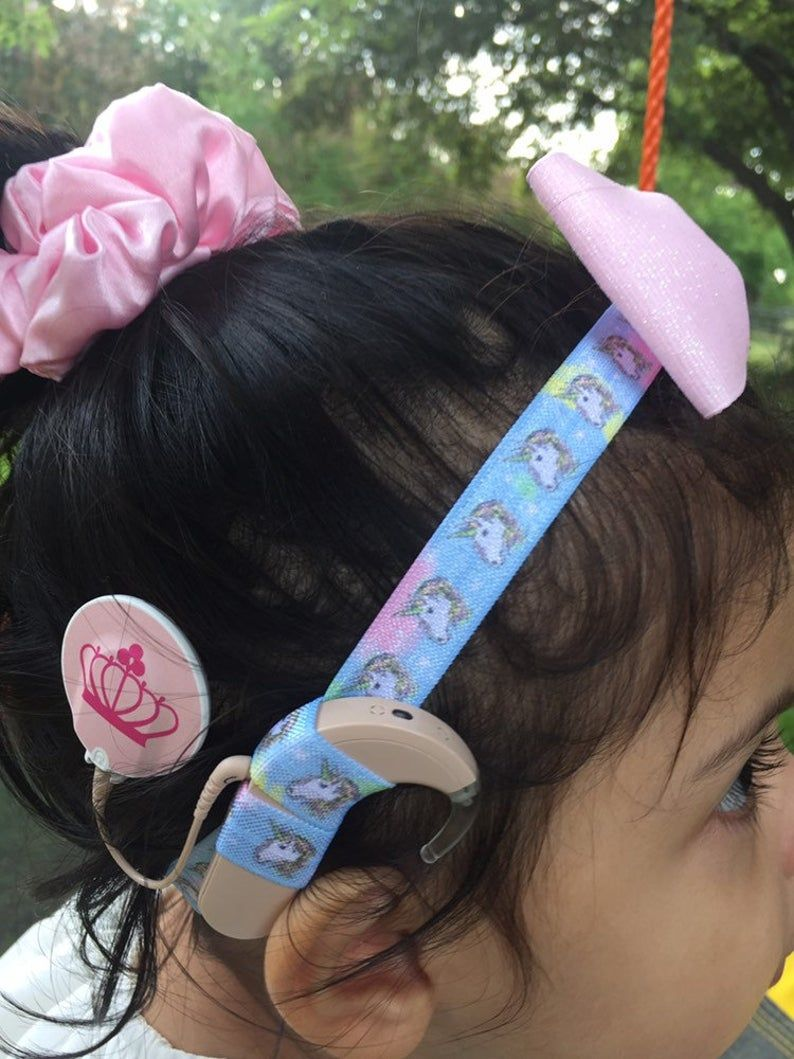 Stretchy unicorn headband with pink bow for cochlear implants or hearing aids