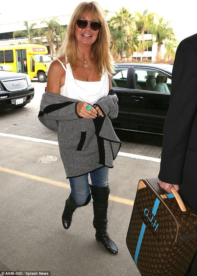 Goldie Hawn arrived at LAX towing a suitcase emblazoned with her initials  GJH for Goldie Jeanne Hawn 196d1517b2f48