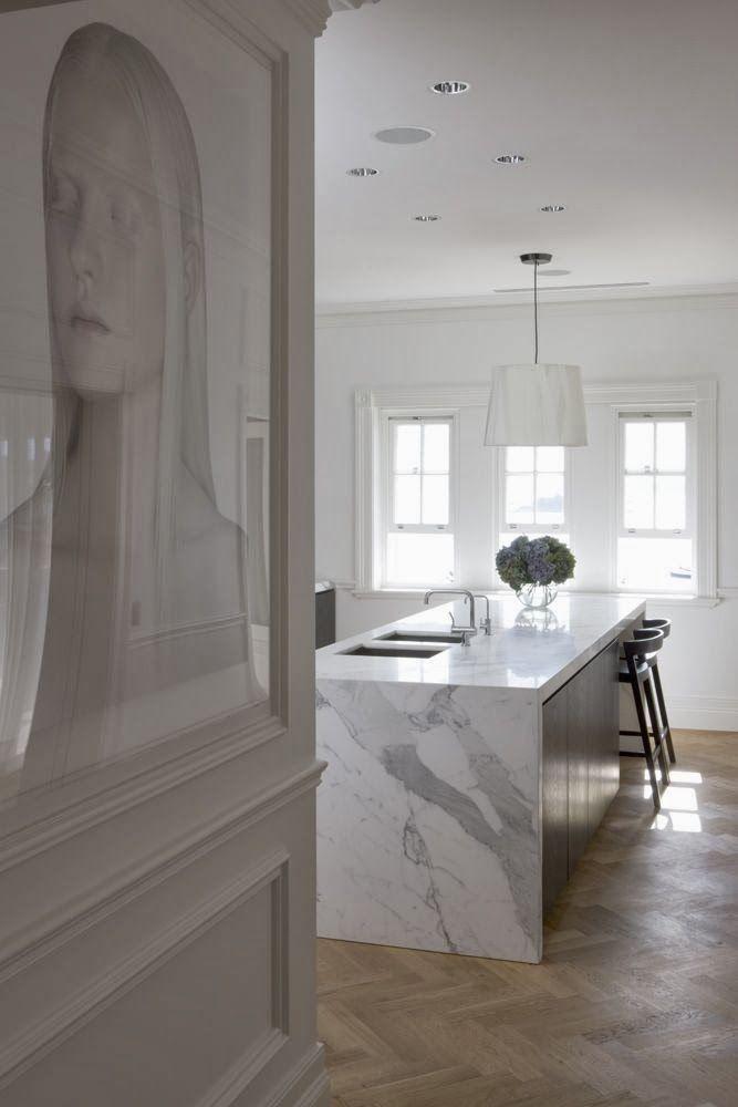 Calacatta marble bench on oak herringbone parquetry for Luxury kitchen flooring