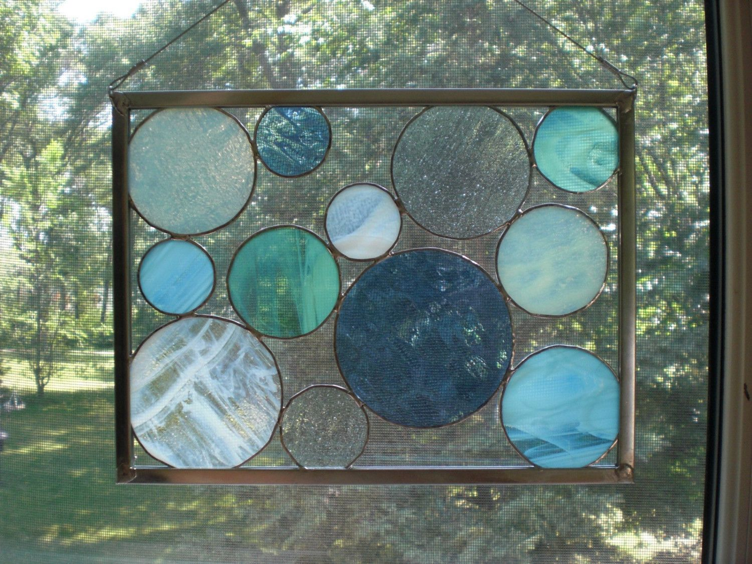 Sea Glass Stained Glass Circles from Sandhill Shores Studio - good idea to use stained glass circle mixed in with the vintage cut glass plates I found thrifting!