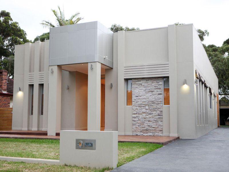 Glass modern house exterior with bi-fold windows & ground lighting ...