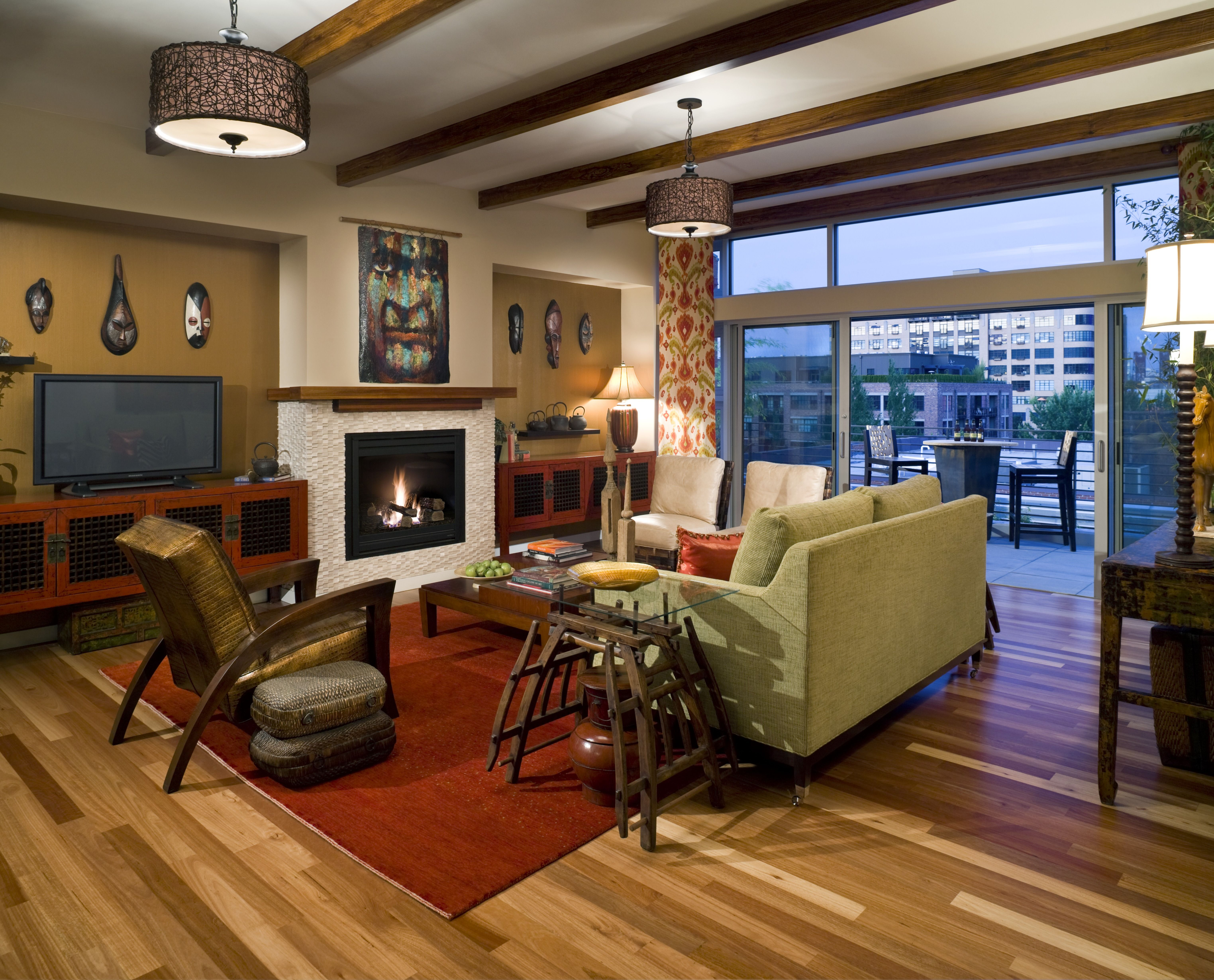 An Eclectic Family Room Design With Sliding Glass Doors Wood Beam