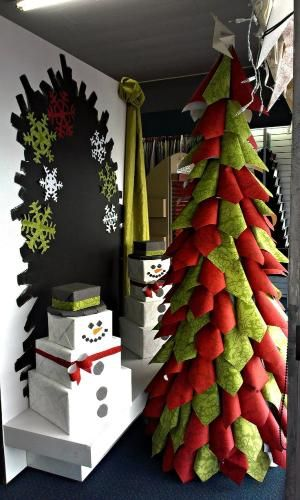 Christmas display ideas Tree and snowmen made out of wallpaper
