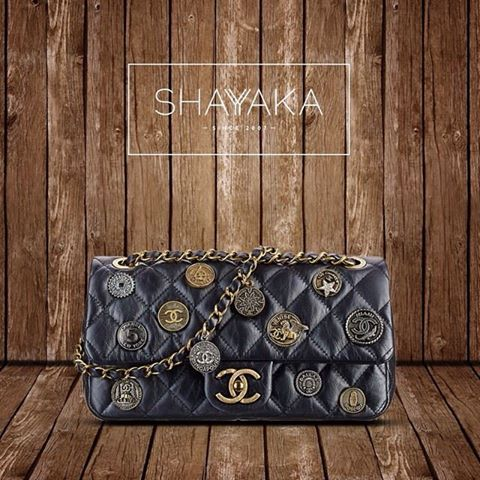 Chanel Flap Bag With Medallions | Cruise 2015 | 15 x 26 x 6 cm | Available Now  For purchase inquiries, please contactsales@shayyaka.com or +961 71 594 777 (Call, SMS, WhatsApp, or iMessage) or Direct Message on Instagram (@Shayyaka). Guaranteed 100% Authentic | Worldwide Shipping | Bank Transfer