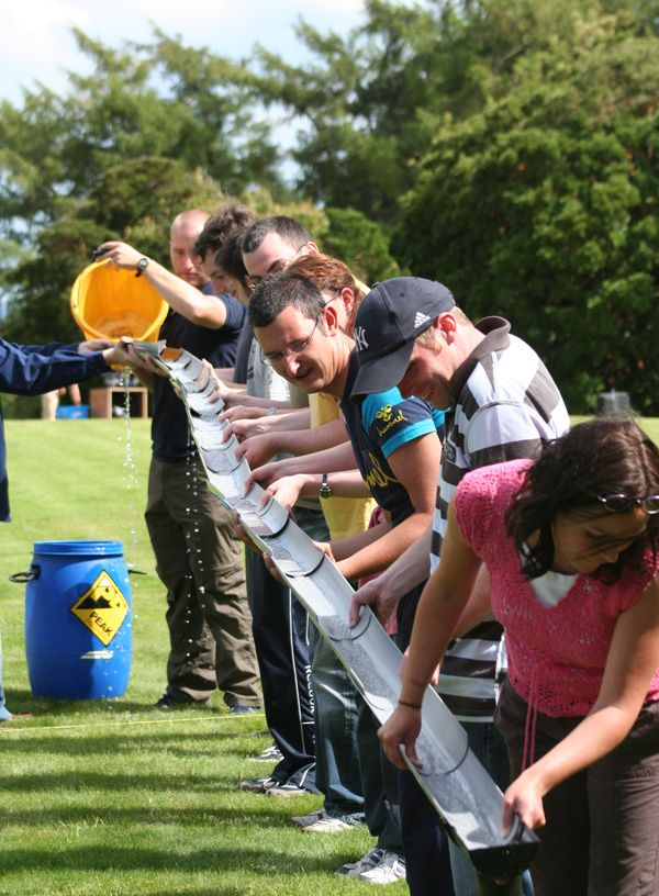 Teams See How Much Water They Can Catch In The Final Bucket