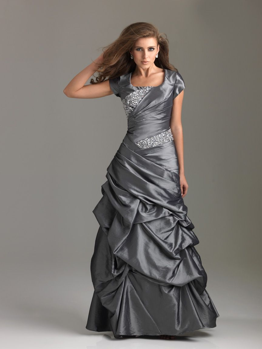 Warm a steely gray pewter or charcoal prom dress with a blush of