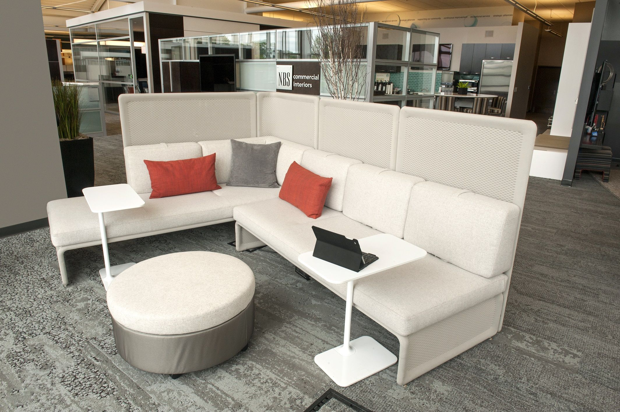Coalesse Lagunitas Lounge with personal tables and Evaneau ottoman