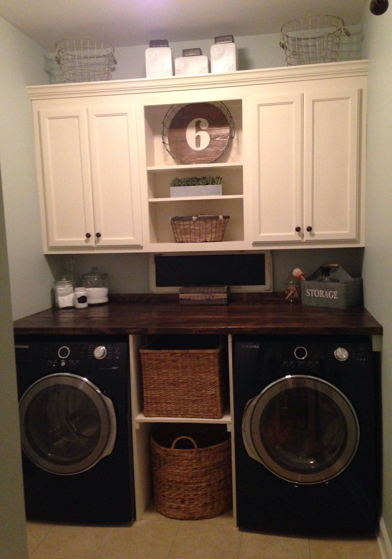 Laundry room makeover but make the bottom middle for Cupboards for laundry room