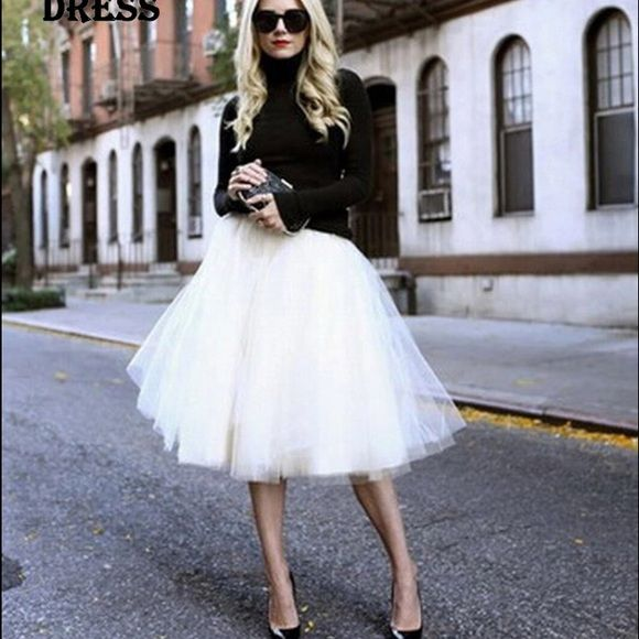 Tutu white tulle skirt Perfect for a date night or for a photoshop. New. It has an elastic waist band. Super stretchy. Skirts Midi