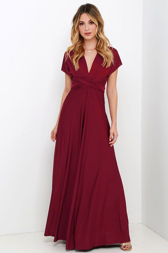 """Any which way you wrap it, the Always Stunning Convertible Burgundy Maxi Dress is one amazing dress! Two, 82"""" long lengths of fabric sprout from an elastic waistband and wrap into dozens of possible bodice styles including halter, one-shoulder, cross-front, strapless, and more. Stretchy burgundy fabric has a satiny sheen, and a full length maxi skirt pairs perfectly with any choice you make up top. Want Styling Tips? <a href='http://bit.ly/HowToWearIt' target='_blank'>See How To Wear It!</a>"""