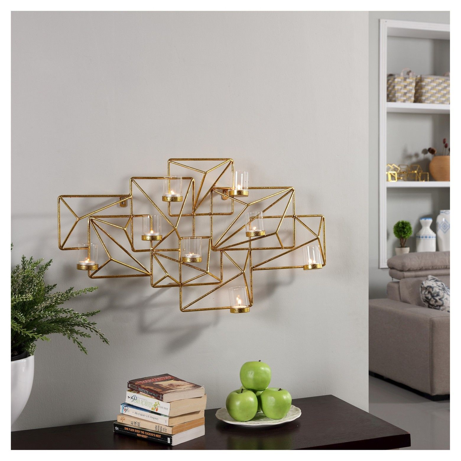 Danya b sparkling gold geometric candle wall sconce is like a piece of art for