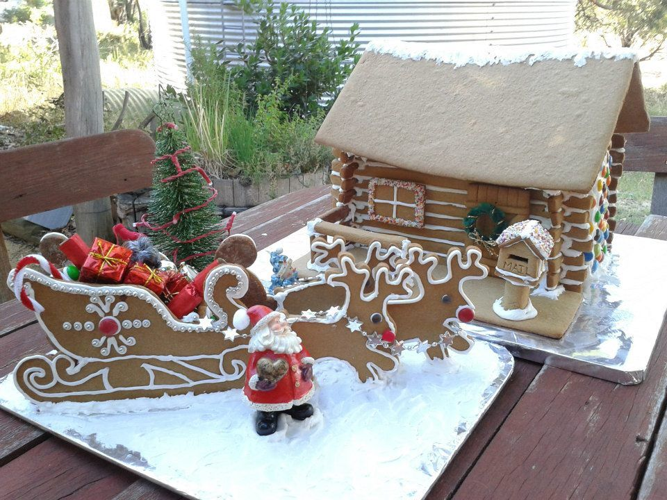 Christmas Gingerbread Sleigh and Reindeer and Log Cabin (2013) - I used a picture from a childrens' colouring book for the sleigh pattern and reindeer cookie cutters for the reindeer. Constructed and decorated by Jennifer Davie - fancy Icing swirly embellishments done by me! Log Cabin Tutorial can be found here; Part 1: http://www.youtube.com/watch?v=j5ZsfCVm8yg Part 2: http://www.youtube.com/watch?v=PNshIk0YzeA