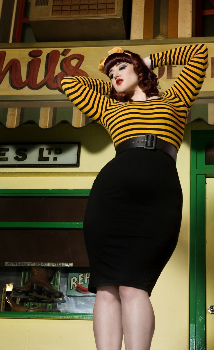 The straight cut shape in plus size gown evens out the figure and ...