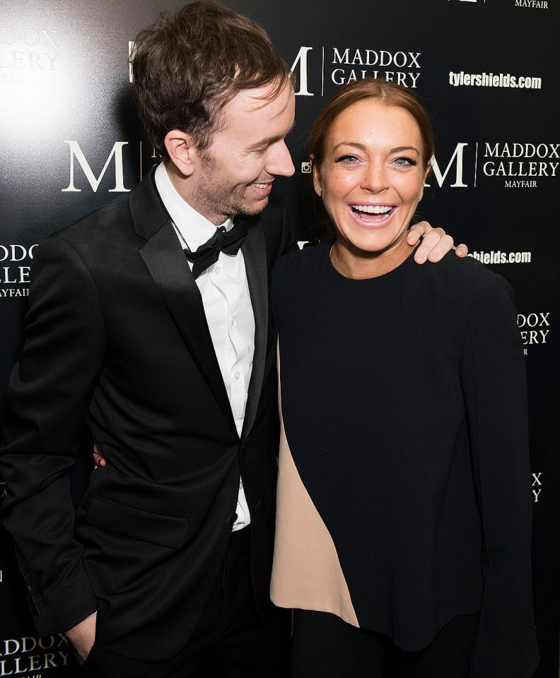 """Lindsay Lohan supports pal Tyler Shields at his London """"Decadence"""" exhibition on Wednesday."""