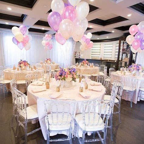 Who says you can 39 t transform a living room into your own for Baby shower hall decoration ideas