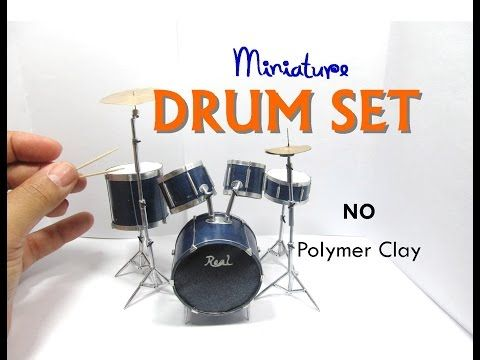 Learn how to make this miniature dollhouse drum set for your miniature band using paper, a wooden skewer stick, toothpicks, some plastic packaging, wire, alu... #dollhouseminiaturetutorials