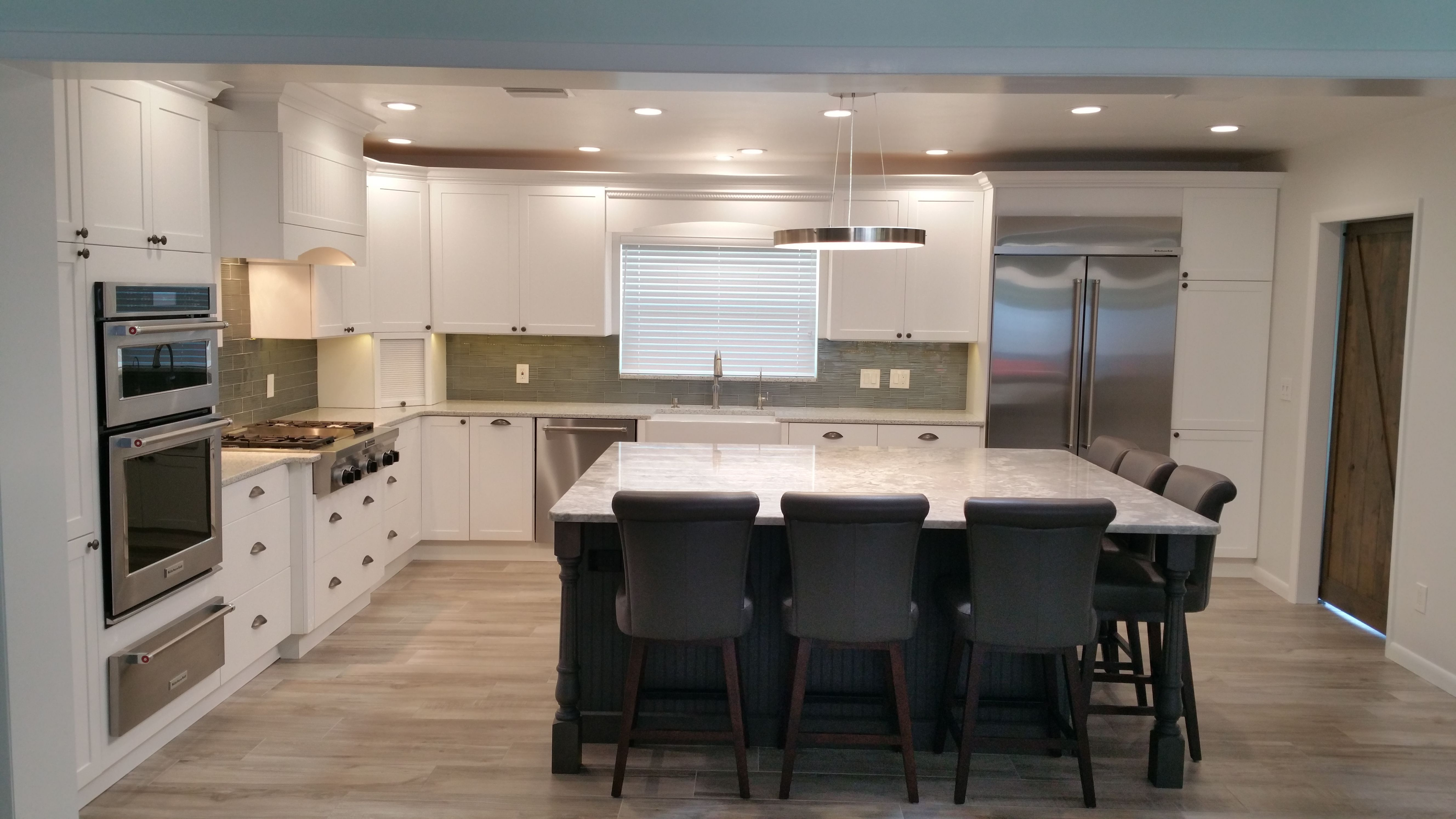 Luxor Pearl White Shaker Style Cabinets And Massive Thunder Grey Island With Marble Top And Swarovsk Shaker Style Cabinets Swarovski Crystal Chandelier Cabinet