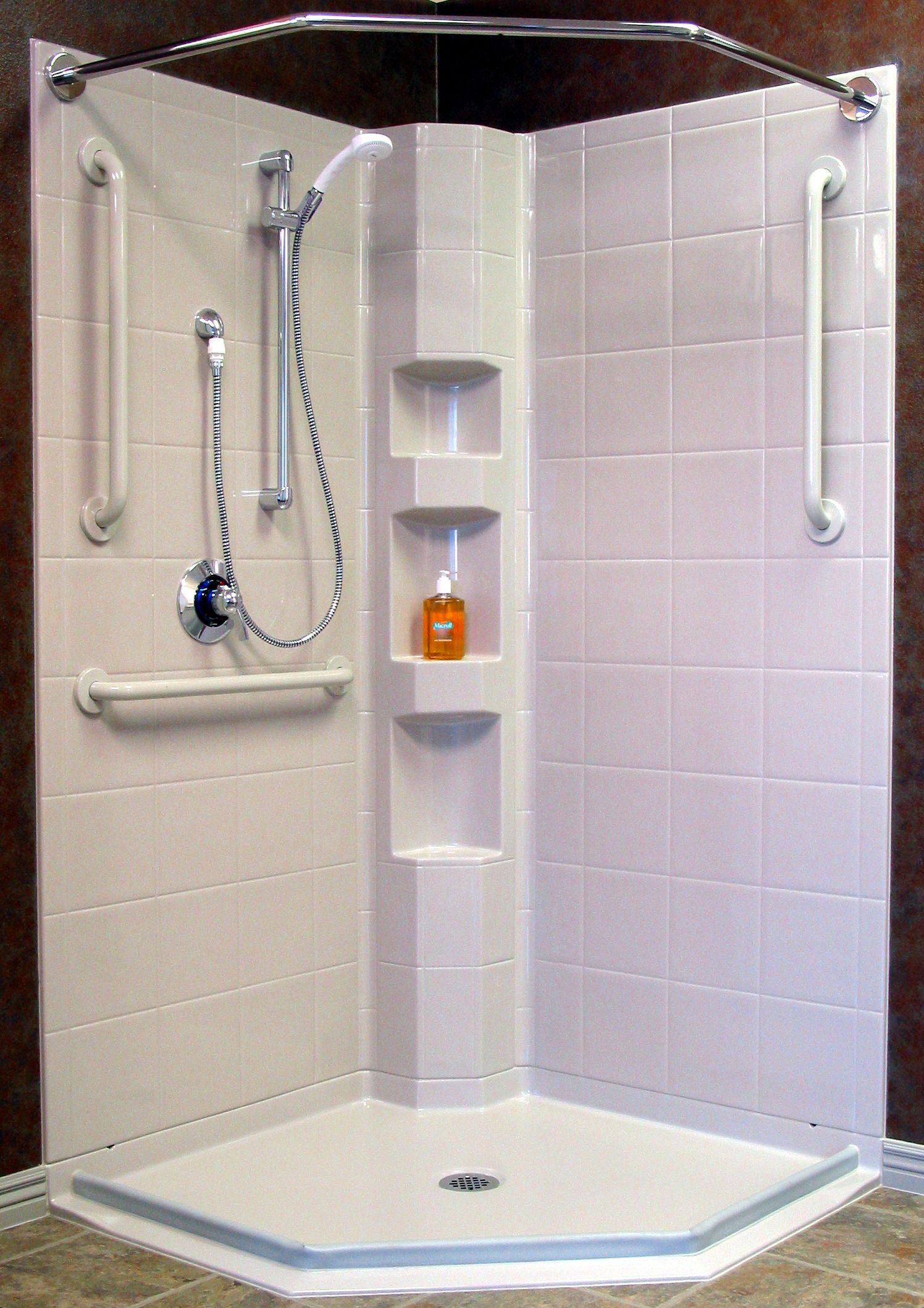 corner shower with barrierfree access and water stopper presloped reinforced drain