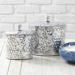 Reims Canisters (Set of 2) | Adorned with vine and grape embossings, this set of two canisters offers a chic container for petite accessories and more.