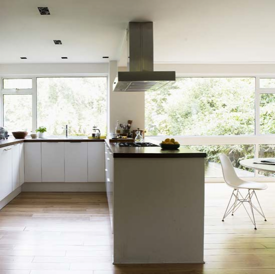 Open Plan Kitchen Ideas Uk the raised back on the island hides kitchen messes from the