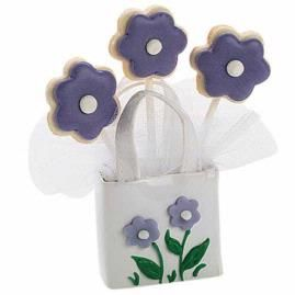 Flavorful Favors Cookie Pops. Send guests home with nosegays meant for noshing. Tuck cookie pops shaped with the largest Flower Cut-Out Fondant Cutter into a Tote Favor Container decorated with fondant flowers.