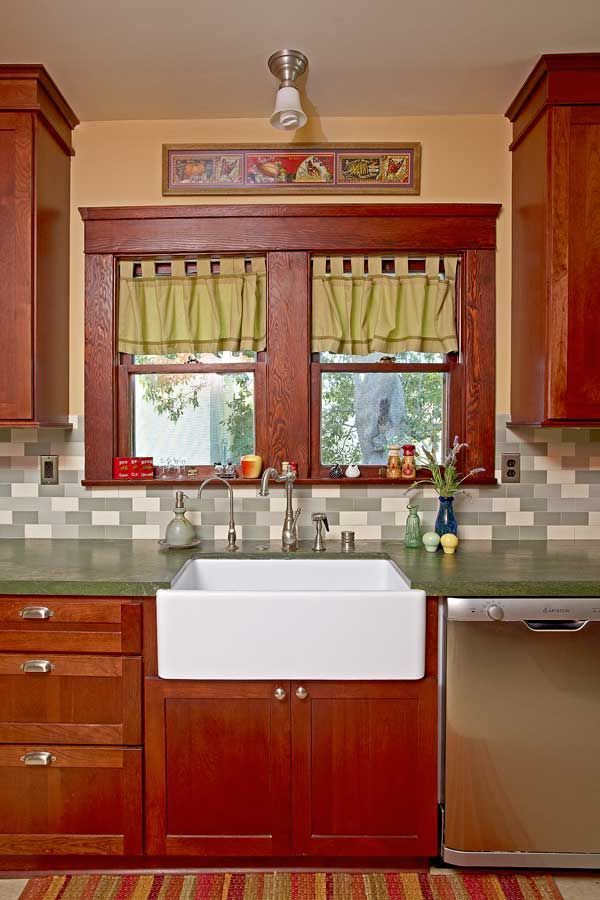 A Well Tended Bungalow Green Tiles And Granite Complement Red Trim Cabinets In The Pleasantly Old Fashioned Kitchen