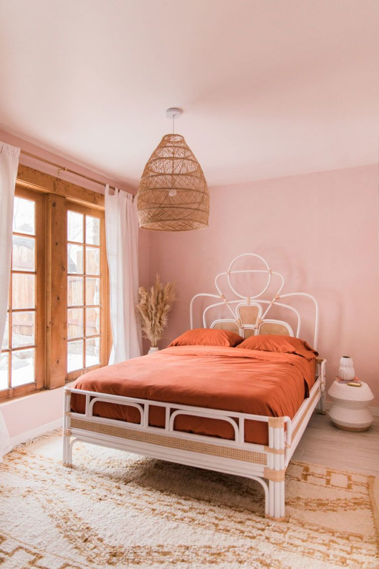 rust orange and pink bohemian desert bedroom in palm ...