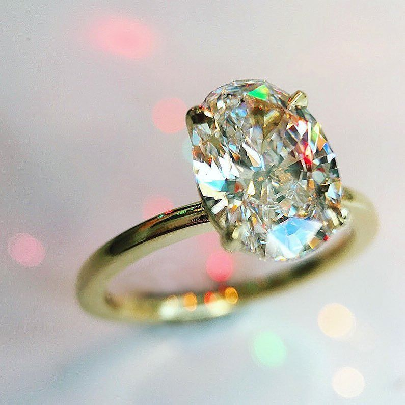 17 Minimalist Oval diamond cut engagement ring