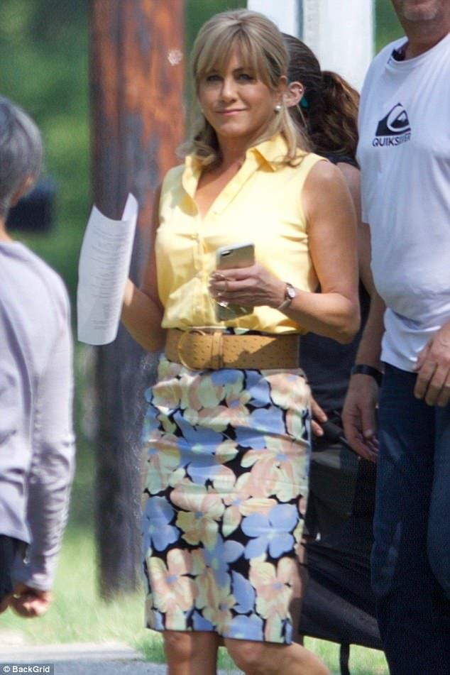Is that you Jen? Jennifer Aniston swapped her glamorous gowns and dazzling red carpet looks for a wholly more minimal look as she arrived on set for her upcoming movie Dumplin, while sporting a prim mumsy ensemble