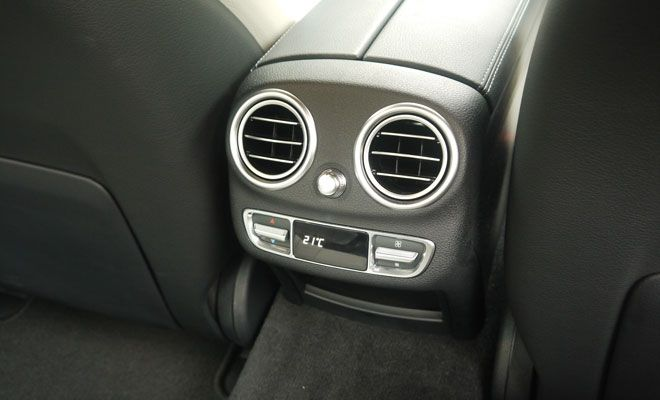 In the back of a Mercedes C-Class, the air vents look happy to see me