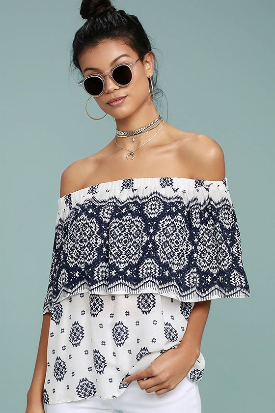 The Tripoli Blue and White Print Off-the-Shoulder Top makes vacation look good! Woven rayon in a classic blue and white print falls from an elastic, off-the-shoulder neckline, into a fluttering flounce atop a wide-cut bodice.